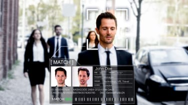 Man in business suit being matched through facial recognition