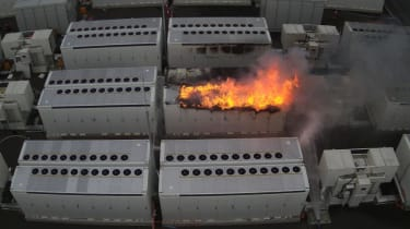 A close up of the Tesla battery on fire