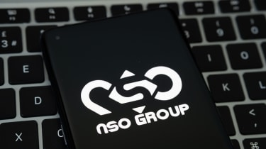 The NSO Group logo on a smartphone that's been placed on a keyboard