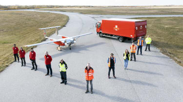 DronePrep and Royal Mail promotional image showing staff stood in front of a red van and plane
