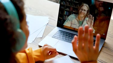Two people waving to each other on a video call