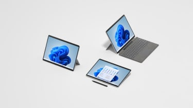 A photograph of three Microsoft Surface Pro 8 units showing different use modes