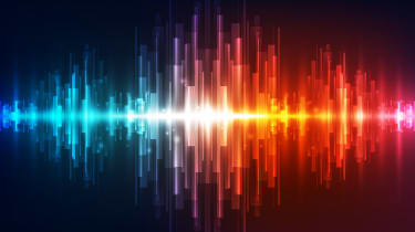 Abstract image showing soundwaves of different colours