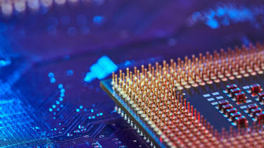 The corner of a CPU chip seen on a circuitboard