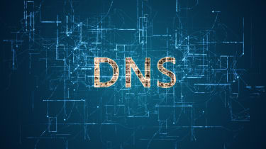 Letters DNS to represent Domain Name System displayed on a blue high tech background