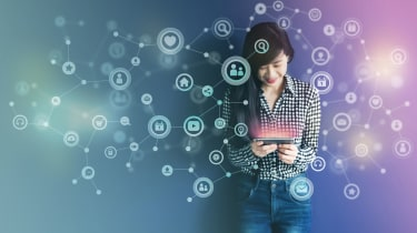 A happy woman holding a device surrounded by a cloud of icons indicating good customer experience
