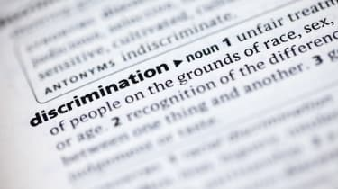 "A photo of an encyclopaedia definition of the word ""discrimination"""