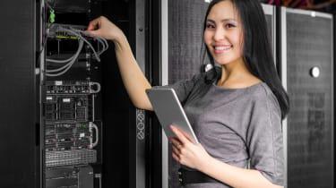 Asian woman working on tech hardware