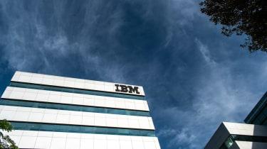 An IBM building as seen against a dark blue, cloudy sky