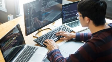 Software engineer examining code from a software