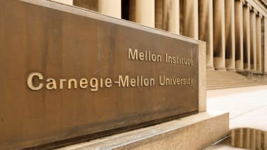 A sign displaying Carnegie Mellon University at the entrance to the school's building