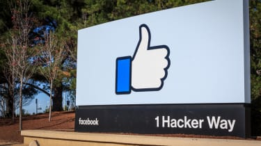Facebook sign at entrance of its campus