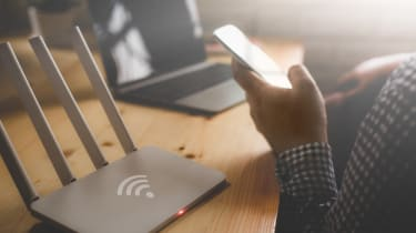 Wi-Fi router with a person holding a cellphone