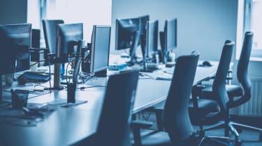 A row of desks in an empty office