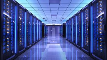 A corridor in a blue-hued data centre