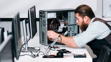 An IT employee repairing a PC