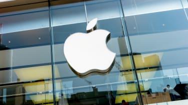 The Apple logo stuck onto a glass building