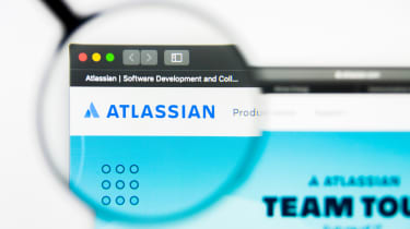 The Atlassian logo on the website seen through a magnifying glass