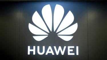 The Huawei logo glowing in a darkened room
