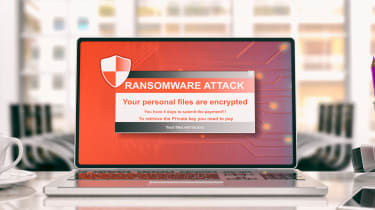 A ransomware splash screen displayed on a laptop in an office