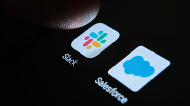 A finger hovering over Slack and Salesforce apps