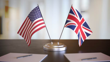 Mini US and UK flags on the desk of an ambassador