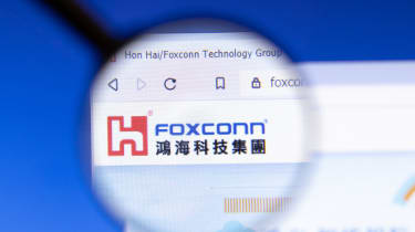 The Foxconn logo on a website under a magnifying glass