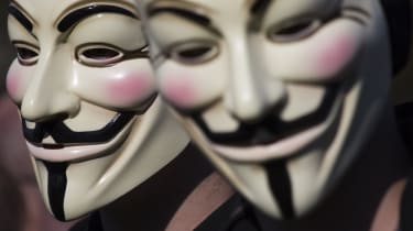 Two masked members of Anonymous demonstrating during the Occupy protest on October 15, 2011 in The Hague