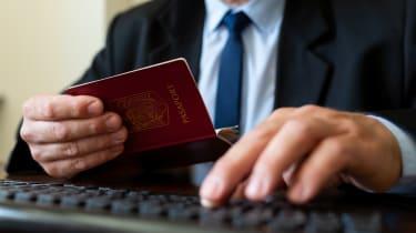 Passport details being checked through a computer