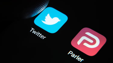 Parler and Twitter app logos on a screen