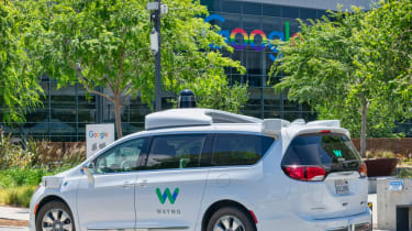 A self-driving Waymo car outside the Google offices