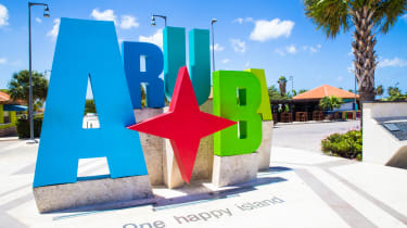Colorful Aruba sign near the beach