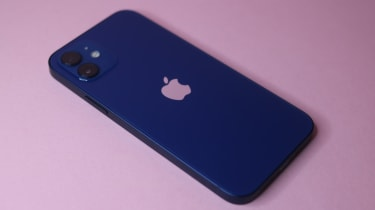 The iPhone 12 in blue on a pink background