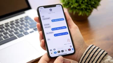 An iPhone user texting using the iMessage app