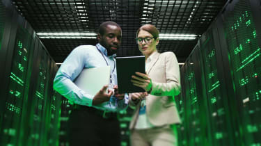Woman and man in a server room