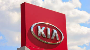 Kia sign with a red background
