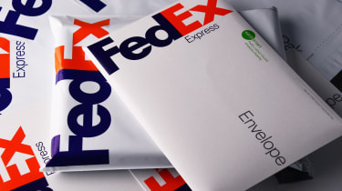 FedEx envelopes stacked messily on top of one another