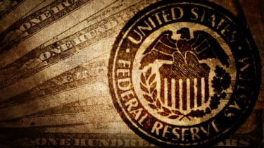 Federal Reserve insignia on overlaid on money