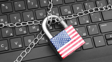 A chain and US flag padlock on a computer keyboard