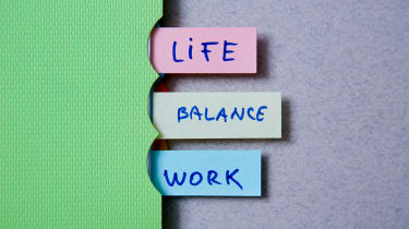 A folder with tabs reading 'life', 'balance', 'work'