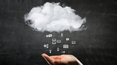 A woman's hand underneath a small white cloud with icons representing different types of data raining out of it on a black chalkboard background