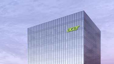 Acer logo on top of glass building with overcast sky in background