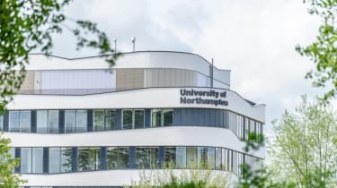 University of Northampton logo sign on new building on nene river