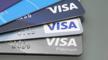 Close-up of Visa credit cards placed on a dark background