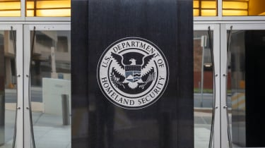 DHS building with the crest on the front of it