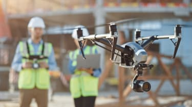 Drone being operated at a construction site