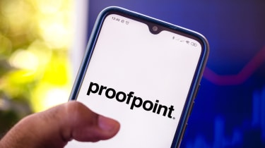 A hand holding a smartphone displaying the Proofpoint logo