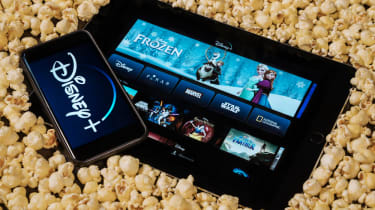 The Disney+ app on two devices sitting in popcorn