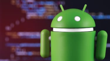 The Android robot in front of lines of code