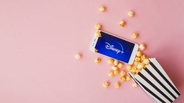 A smartphone with Disney+ and popcorn